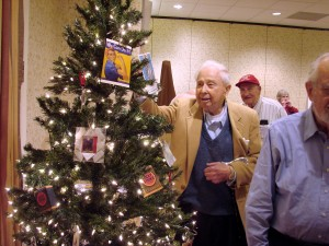 Veterans placing their pictures on the tree