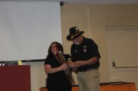 Tiffany Hoffmann receiving her Figurine from Gordon Jones.