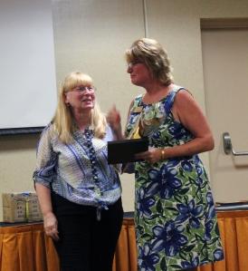 Lora Warren-Davis receiving her Plaque