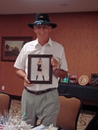 Tommy Betts with his picture from Nancy Sinatra