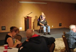 Jerry Duckworth being serenaded by C.J. Newsom our entertainer at the Meet and Greet.