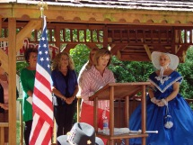 """Peggy Carpenter Reading some of the names of """"Our Fallen"""". Gwynn Smith, Branda Merritt and Rose Cairns also read names. Robert """"Dutch"""" Florez rang a bell after each name was read."""